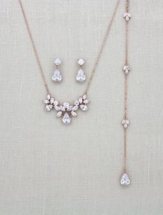 Lovely simple Bridal backdrop necklace and earrings set created by me in Rose Gold finish Swarovski Pure Brilliance cubic zirconia components. Necklace set comes in three finishes, Rose Gold, Rhodium and 18K yellow gold. Necklace portion measures 16 inches and extends to 18 inches.