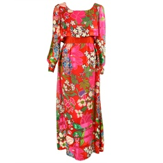 Richilene silk chiffon floral gown   United States, 1970's   Over bodice has scoop neck and long billowing sleeves that snap at the wrists. A-line skirt is ankle-length. Red satin waistband. Center back zipper with snap closure in the over bodice. Lined