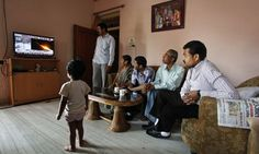 Indian family watching missile launch. Image from Guardian.