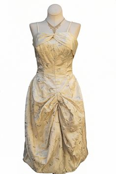 Cabaret Vintage - 1950s Ivory Cocktail Dress with Silver Embroidery, $285.00 (http://www.cabaretvintage.com/new-arrivals/1950s-ivory-cocktail-dress-with-silver-embroidery/)