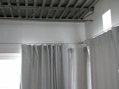 How to DIY your very own Ikea style custom curtain cable system. I love the Dignitet from Ikea, but it doesn't give you the versatility that making your own does. Perfect for sliders, arches, windows, canopy beds, kid's artwork displays.. the list goes on and on. Cover with a valance if you like the traditional look, leave exposed for a modern industrial feel.