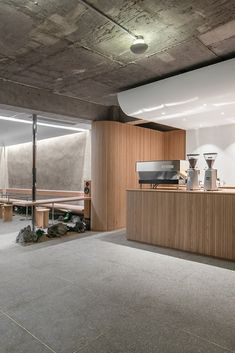 Sleek design is paired with traditional Korean elements at Cafe Oriente in Seoul's creative Itaewon neighbourhood. Designed by local practice, Labotory, the cafe is partially submerged into the ground and features a combination of raw concrete, untreated wood, gravel, rock and a touch of greenery.  Photography: Yongjoon Choi  #southkorea #seoul #cafe #minimalistdesign #minimalism #design #travel #concrete #interior #interiors #interiorstyle    Wood Interior Design, Interior Styling, Restaurant Interior Design, Interior Modern, Furniture Design, Cafe Shop Design, House Design, Wood Cafe, Korean Cafe