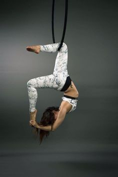 Aerial Hoop/Aerial Lyra. Ultimate show of flexibility. Cacoon on the lower bar.