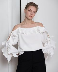 The Calin Top in White featuring thin straps, square neckline, dimple sleeves in ruffle detailing with self-tie. COMPOSITION AND CARE Dry clean only Please treat with care to extend the life Sleeve Designs, Blouse Designs, Vetement Fashion, Little White Dresses, Trendy Tops, Stylish Tops, Lace Tops, Blouses For Women, Trendy Outfits