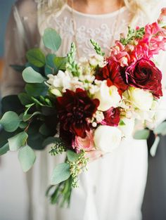 bouquet with silver dollar eucalyptus - photo by Christine Barlow Photography http://ruffledblog.com/cobalt-and-gold-bridal-inspiration #weddingbouquet #flowers #bouquets