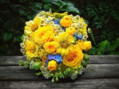 Beautiful Wedding Bouquet: Blue Hydrangea, Yellow Roses, Yellow Gerbera, Yellow Zinnia, Chamomile Daisies, Yarrow, Feverfew.... Bouquet by Spring Well Gardens Near Raleigh, NC