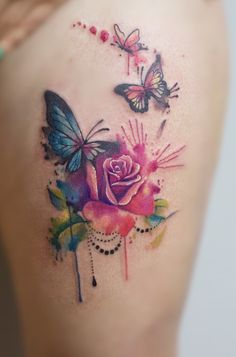 I would love this watercolour tattoo on my thigh with a clock on the top right corner!