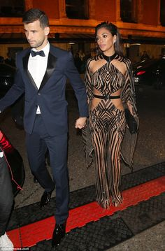 Cute couple:Nicole Scherzinger certainly seemed in good spirits as she followed her 25-year-old beau out of the British Fashion Awards in London on Monday