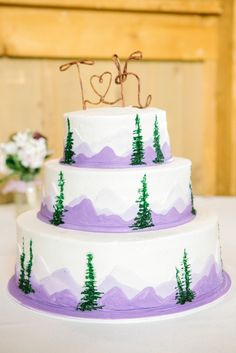 Purple and white themed mountain-inspired wedding cake // Kerinsa Marie Photography // http://www.theknot.com/submit-your-wedding/photo/49b71f67-8e7c-4371-9e72-e0f90e78ad8c/Ten-Mile-Station-Wedding