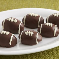 These chocolate cookies are decorated to look like footballs - the perfect game day dessert!