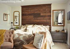 DIY floor to ceiling wood pallet headboard.