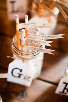 school themed wedding - name cards with table numbers!