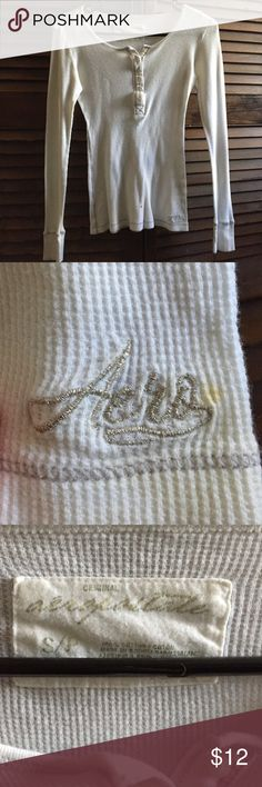 Shirt White long sleeve Aeropostale Henley • Size Small • One little stain at the bottom by the logo (see pics) Several years old but in good condition Aeropostale Tops Tees - Long Sleeve