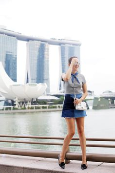 Andy Torres wearing a zara blue denim skirt and Dior sunglasses in Singapore
