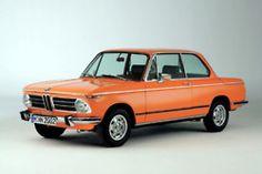 it's the BMW 2002.  why didn't they rerelease it in 2002?  I was ready to buy one.
