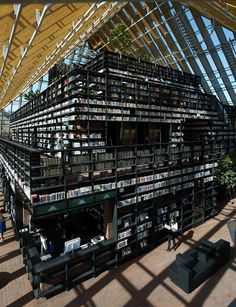 "The ""Book Mountain + Library Quarter""  in the market square in Spijkenisse, Netherlands, by  Rotterdam-based MVRDV architecture.  The peak of this mountain is home to a reading room and cafe with views of all adjacent areas through the glazed ceiling."