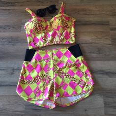 Nicki Minaj two piece set Chain link pink and yellow cute set! Size medium. Could be used as a swimsuit though i don't think it actually is a swimsuit ✌️ adjustable straps - brand is nicki Minaj collection Nicki minaj Tops Crop Tops