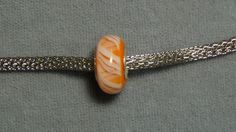 European glass bead orange white stripes Clemson big hole 197
