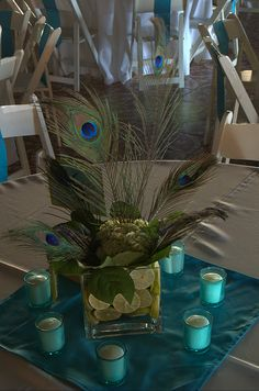 This look's cool and easy to make, i like the peacock theme Peacock Wedding Centerpieces, Wedding Flower Arrangements, Wedding Flowers, Wedding Decorations, Centrepieces, Feather Decorations, Blue Centerpieces, Centerpiece Ideas, Decor Wedding