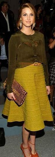Who made Whitney Port's yellow skirt, top, and orange ankle strap pumps that she wore in New York on September 9, 2011? Sweater and skirt – Luca Luca  Shoes – Giuseppe Zanotti