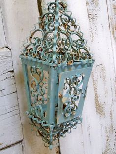Reserved for Kay 10-20-12 Vintage shabby chic lantern light blue rusty metal farmhouse scroll candle holder ooak Anita Spero. $155.00, via Etsy.