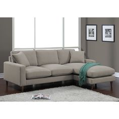 Lounge in total comfort with the Shaffer two-piece sectional designed with soft cushions and plush--with foam surrounded by down, poly fill and poly fiber. The espresso-finished solid wood legs are a perfect complement to soft grey fabric upholstery.