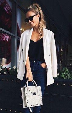 ponytail + sunglasses + black tank + white jacket