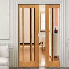 Double Pocket River Oak Darwen 3 Pane sliding door system in three size widths with Clear Glass. #glazedoakslidingdoors #internaldoubleoakslidingdoors #internalmodernslidingdoors