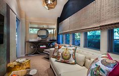 Interior designer Sarah Z featured Glam Grass 5205 Egyptian Gold and Vinyl Snakeskin 8075 Sea Serpent in the living room of the 2016 Junior League of Miami Showhouse.