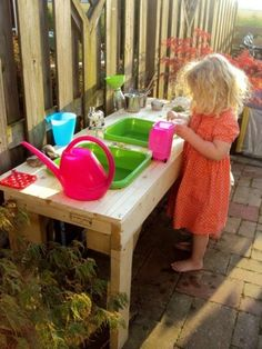 Outdoor play kitchen/water table) - find a table, cut two holes - insert plastic tubs./ If you don't have a water table , make one!
