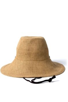 Softly structured, breathable woven jute hat with wide brim, cotton chin straps, and stitched band detail along a wide brim. 100% jute outer with 100% cotton lining. Measurements: Small: 22 (56cm) Medium: 22 7/8 (58cm) Handmade in NYC