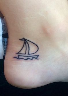 Sailboat on an ankle tattoo