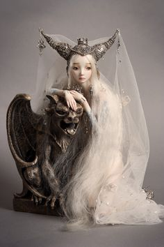 Porcelain Beauties by Marina Bychkova.  She creates magnificent works of art.
