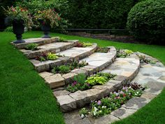 Beautiful stone steps for sloping backyard. Love how the flower beds frame the steps!