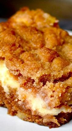 A moist apple coffee cake layered with luscious cream cheese and a crumbly streusel!.