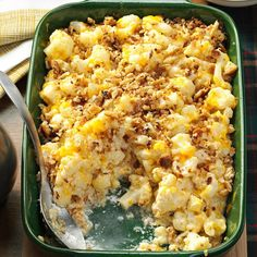 Christmas Cauliflower Casserole Recipe -This creamy casserole is filled with tender cauliflower and topped with a sprinkling of crispy herb stuffing. It's become a holiday classic that appeals to both kids and adults in our family. —Carol Rex, Ocala, Florida