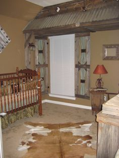 Rustic Lodge Nursery.  I like this idea for the basement, to cover the under the stair area.  Minus the crib, of course! :)