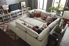 Like the bookcase/TV stand and the orange rug. Bassett Rooms We Love!