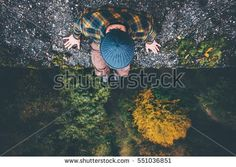 Man Traveler sitting on cliff bridge edge with forest aerial view Travel Lifestyle adventure vacations concept