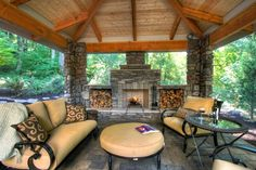 Covered patio with outdoor fireplace. Great storage areas for extra firewood.