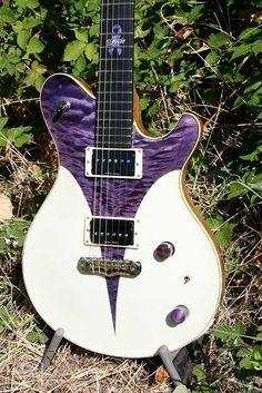 Another very unique guitar from Jason Schroeder. The Josie Guitar http://www.schroederguitars.com/guitars/gallery/josie-guitar#