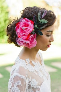 Pretty hot pink flowers in her hair | Photography by Jason Tey Photography / jasontey.com,