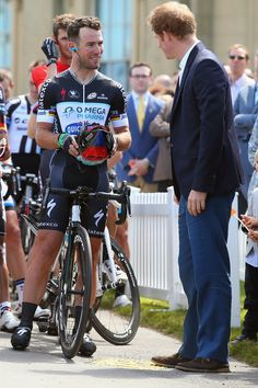 Mark Cavendish of Great Britain and Omega Pharma - Quick Step chats to Prince Harry at the start of stage one of the 2014 Tour de France, a 190km stage between Leeds and Harrogate, on July 5, 2014 in Harrogate, England.
