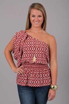 TRIBAL IKAT TOP...AHHH we can hardly take the cuteness!!! This adorable one shoulder top features an ikat print and a smocked waist. Thanks to the deep red and white color combo this can easily be worn for gameday, or just because it's super cute:)) The smocked waist makes it comfy, and thanks to the lightweight material you won't be too hott in the warmer months!