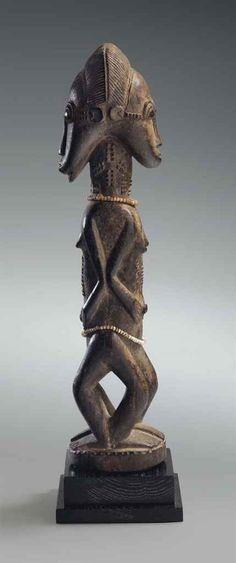 A UNIQUE BAULE ANCESTRAL JANIFORM MALE & FEMALE FIGURE Bouake region, Ivory Coast wood, glass beads Height: 14 in. (35.6 cm.)