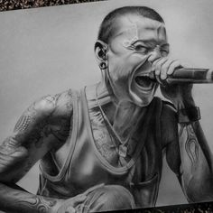 This is a GREAT drawing of Chester Bennington! Just like how my dad would draw, lots of detailing and shadowing. I applaud the artist for such GREAT work! kslp