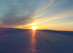 sunset-ice-roads - Ice road scenery. Rounding the bend on a frozen lake on the ice roads of Northern Canada.
