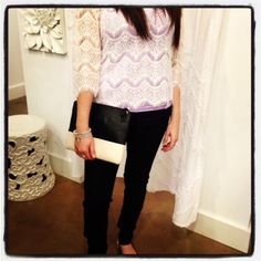Make your lace blouse look smart by pairing with Impeccable Pig's edgy clutch and slim black pants.