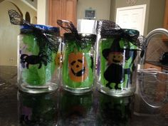 DIY Halloween light up jars. Using flameless candles and window decals.