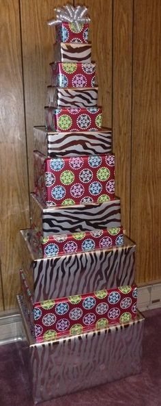 Gift Giving: 12 Days of Christmas The site lists expensive gifts to give, but this would be a cute idea to give a present tree for them to open one gift a day! LOVE IT